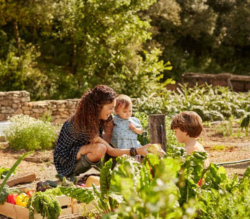 mother and children in garden