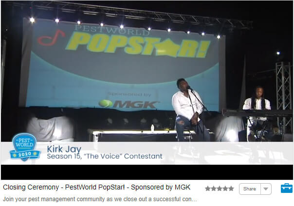 Screenshot of closing ceremony; Kirk Jay singing on stage with piano accompaniment, and backdrop with PestWorld Popstar logo and MGK logo