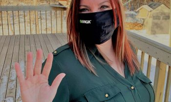 Lindsay Sillman - International Women's Day pose with hand up, wearing MGK branded mask